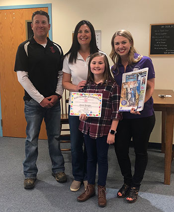 Big Red Tool owners, Kyle and Kerri Sandoval, and Sarah Oliver from San Juan College present Emily Boognl with a Kids Kollege Scholarship for being chosen as the Student of the Month.