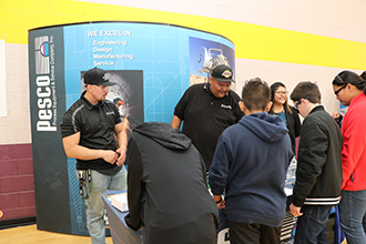 Students visiting the PESCO booth at the Career Expo lunch.